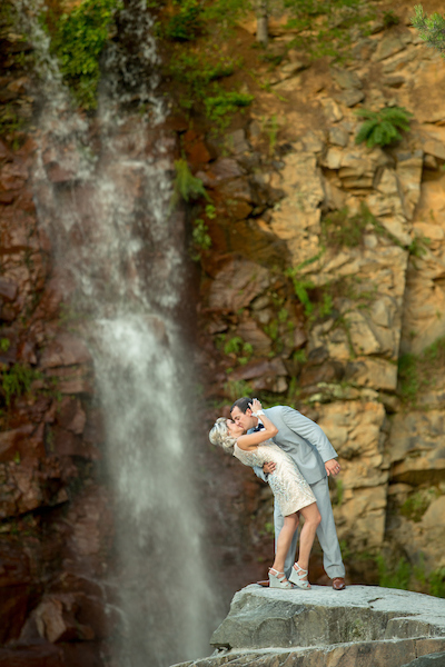 An Outdoor Wedding With A Waterfall Backdrop Bustld Planning Your Wedding Just Got Easier